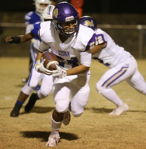 Ozona High School's Zackary Talamantez picks up yardage against Winters during a District 3-2A Division I showdown at Blizzards Stadium on Friday, Nov. 1, 2019.