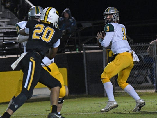 Calvary's Cade Hart looks for an open receiver against Haynesville in a District 1-1A contest Friday at Red Franklin Stadium.