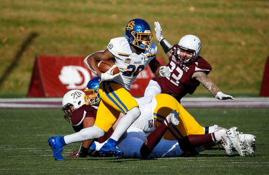 South Dakota State running back Pierre Strong Jr. carries the ball around Missouri State defenders as the Jackrabbits take on the Bears at Plaster Field in Springfield, Mo. on Saturday, Nov. 2, 2019.