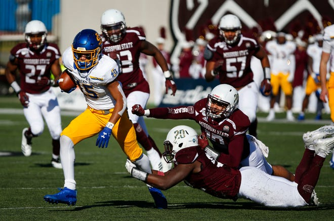 South Dakota State receiver Cade Johnson carries the ball as Missouri State's Tylar Wiltz and McNeece Egbim attempts to make a tackle as the Bears take on the Jackrabbits at Plaster Field in Springfield, Mo. on Saturday, Nov. 2, 2019.19.