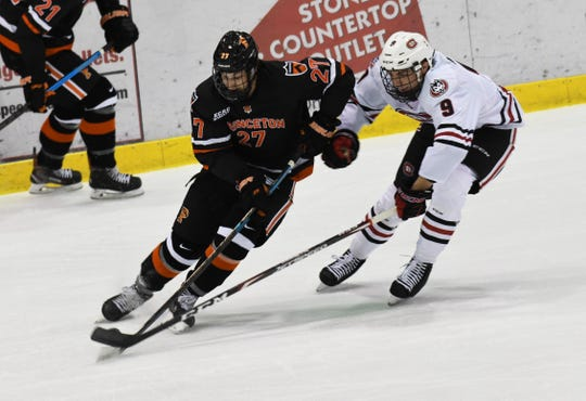 St. Cloud sophomore defenseman Spencer Meier tries to disrupt a Princeton attack in Friday's nonconference contest.