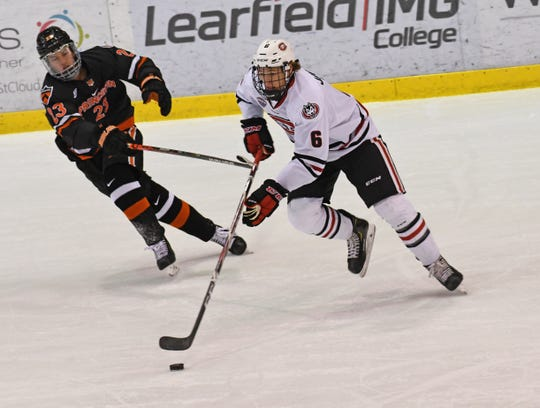 St. Cloud's Luke Jaycox skates past a Princeton defender in Friday's nonconference battle at the Herb Brooks National Hockey Center.