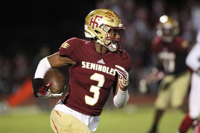 Florida State University School junior Ahmari Harvey returns a kickoff against Leon on Nov. 1. 2019.