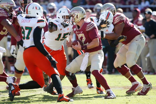 Nov 2, 2019; Tallahassee, FL, USA; Miami Hurricanes defensive lineman Gregory Rousseau (15) pressures Florida State Seminoles quarterback Alex Hornibrook (12) in the backfield during the first quarter at Doak Campbell Stadium. Mandatory Credit: Glenn Beil-USA TODAY Sports