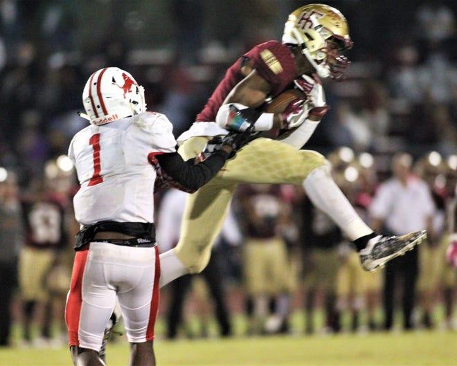 Florida High junior Ahmari Harvey makes an interception as Florida High beat Leon 47-10 on Nov. 1, 2019.