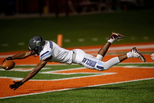 Maclay wide receiver Robert Parker-Crawford (1) dives into the end zone for a touchdown. The FAMU DRS Rattlers hosted the Maclay Marauders at Bragg Memorial Stadium on Friday, Nov. 1, 2019.