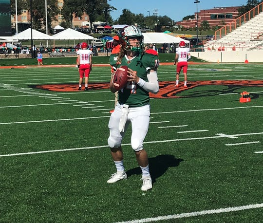 FAMU quarterback Ryan Stanley warms up for the game versus Delaware State. He broke the career record for touchdowns in the 52-30 win over the Hornets.