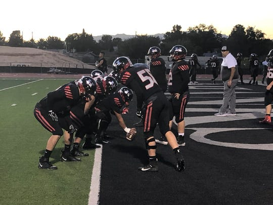 Hanks warms up before their game at Ysleta Friday night