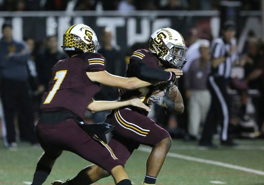 Quarterback Travis Throckmorton, left, running back Ranell White and Simi Valley will play Western at Ocean View High on Friday night in a Division 10 first-round game.