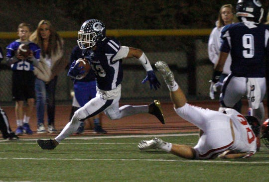 Camarillo High senior Jesse Valenzuela is off and running during Friday night's showdown with Grace Brethren at Moorpark College. The Scorpions suffered their first loss of the season as the Lancers secured their second straight Camino League title in the regular-season finale.