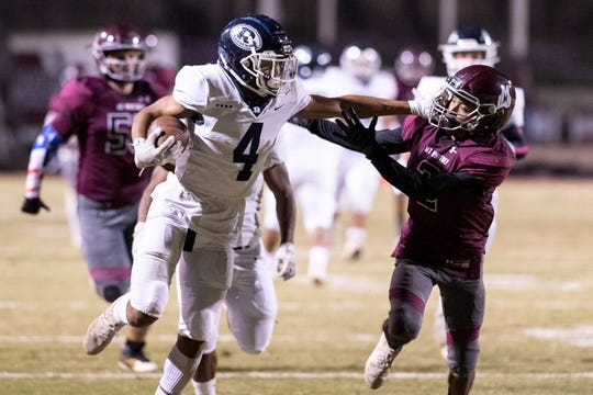Redwood's Diamond Davis fends off Mt. Whitney's Josue Cisneros in the annual Cowhide rivalry game on Friday, November 1, 2019.
