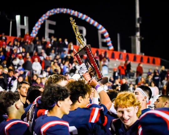 Tulare Western players celebrate their win over Tulare Union for the East Yosemite League championship in the 55th annual Bell Game at Bob Mathias Stadium on Friday, Nov. 1, 2019.