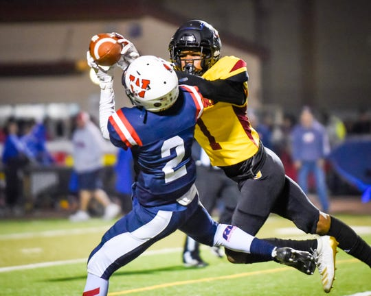 Tulare Western's Mark Smith hauls in a reception against Tulare Union in the 55th annual Bell Game at Bob Mathias Stadium Friday, Nov. 1, 2019.