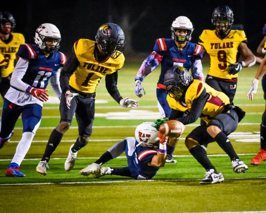Tulare Western and Tulare Union players scramble for a loose ball in the 55th annual Bell Game at Bob Mathias Stadium Friday, Nov. 1, 2019.