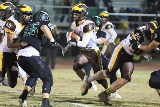 Golden West's Michael Wessel runs against El Diamante in the 16th annual Battle of the Saddle game at Visalia Community Stadium on Friday Nov 1st, 2019.