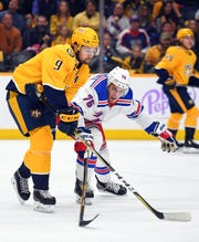 Nov 2, 2019; Nashville, TN, USA; Nashville Predators left wing Filip Forsberg (9) passes the puck against New York Rangers defenseman Brady Skjei (76) during the first period at Bridgestone Arena. Mandatory Credit: Christopher Hanewinckel-USA TODAY Sports