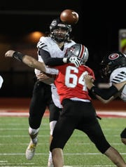 Rye quarterback Declan Lavelle passes under pressure from Somers' Danny Curran during their Class A semifinal at Somers Nov. 1, 2019. Rye won 28-20.