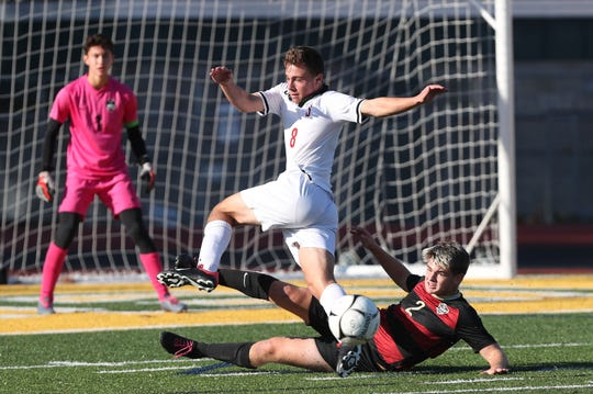 From left, Somers Bennett Leitner (8) and Rye's Nic Logan (2) get tangled up going after the ball during the Section 1 Class A championship game at Lakeland High School in Shrub Oak Nov. 2, 2019. Rye won the game 3-2.