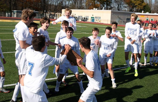 Bronxville players celebrate with the Section 1 plaque after defeating Hastings 2-0 in the Class B championship game at Lakeland High School in Shrub Oak Nov. 2, 2019.