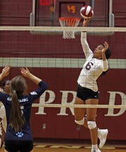 Ossining's Mychael Vernon (6) spikes the ball during Section 1 Class AA volleyball quarterfinals at Ossining High School on Nov. 1, 2019.