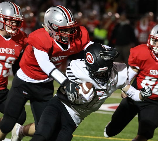 Rye's Matthew Tepidino is tackled by by  Somers' Zach Nyikos during their Class A semifinal at Somers Nov. 1, 2019. Rye won 28-20.