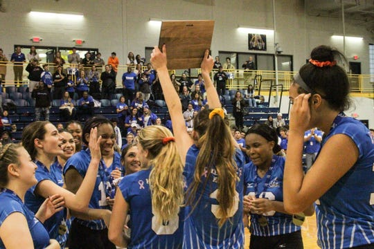 Hen Hud celebrates winning the Section 1 Class A championship after sweeping John Jay-Cross River in the Saturday, Nov. 2, 2019 final.
