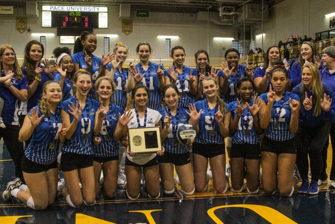 Hen Hud poses with the Section 1 Class A championship plaque, after beating John Jay-Cross River in the title game on Saturday, Nov. 2, 2019.