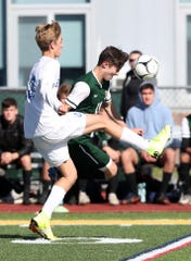 From left, Bronxville's Aidan Sulimirski (23) and Hastings'  Marcus Hirt  battle for ball control during the Section 1 Class B championship game at Lakeland High School in Shrub Oak Nov. 2, 2019. Bronxville won the game 2-0.