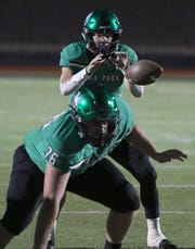 Iowa Park's Trent Green gets the ball during the game against Bridgeport Friday, Nov. 1, 2019, at Hawk Stadium. THe Hawks defeated the Bulls 50-29.