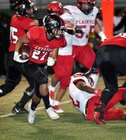 Wichita Falls High running back Bricen Vialpando (27) cuts outside during first quarter action against Plainview Friday night at Memorial Stadium. WFHS defeated Plainview, 31-6.