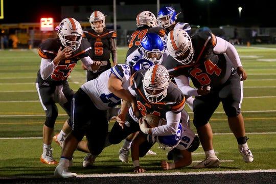 Burkburnett's Austin Childs dives in for the touchdown against Decatur Friday in Burkburnett.