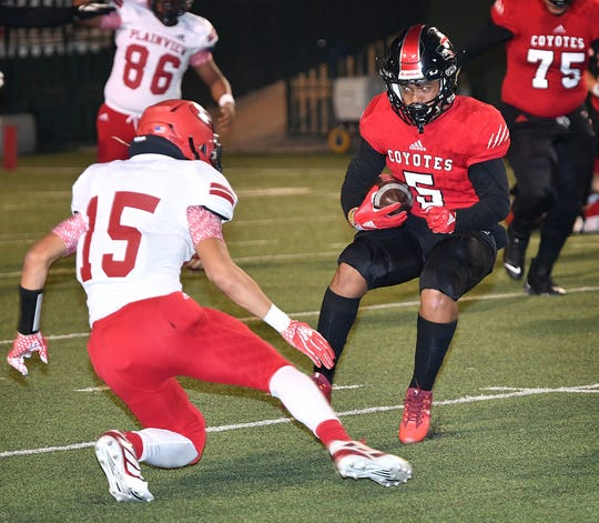 Khelyn Sapp (5) of Wichita Falls High fakes out Plainview linebacker Jayden Barrera (15) during second quarter action Friday night at Memorial Stadium. WFHS defeated Plainview, 31-6.