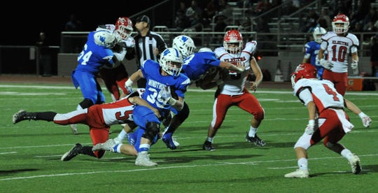 Windthorst runningback, Ethan Belcher, works to break a tackle during the Trogan's game against the Electra Tigers Friday night.