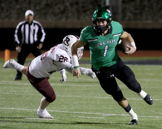 Iowa Park's Trent Green breaks away from Bridgeport's Caleb Bartlett Friday, Nov. 1, 2019, at Hawk Stadium. THe Hawks defeated the Bulls 50-29.