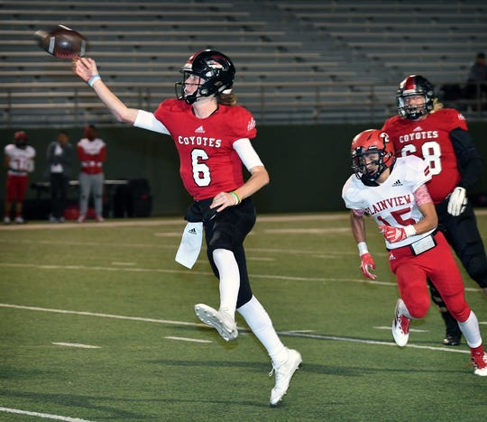 Wichita Falls quarterback Zy Gravitt (6) throws on the run for the first touchdown of the night against Plainview. The Coyotes beat the Bulldogs, 31-6, at Memorial Stadium.
