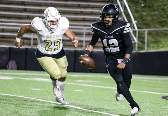 Rider defensive lineman Ian Storey (25) pursues Canyon Randall quarterback Jakobe Norman during a District 3-5A Division II game played Friday, Nov. 1, 2019 at Kimbrough Memorial Stadium in Canyon.