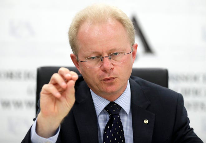 Mark Schipp, the President of World Organization for Animal Health briefs media in Sydney, Thursday, Oct. 31, 2019, on the threat of African swine fever. Schipp says that the spread of the disease in the past year to countries including China, which has half the world's pig population, had inflamed a worldwide crisis.