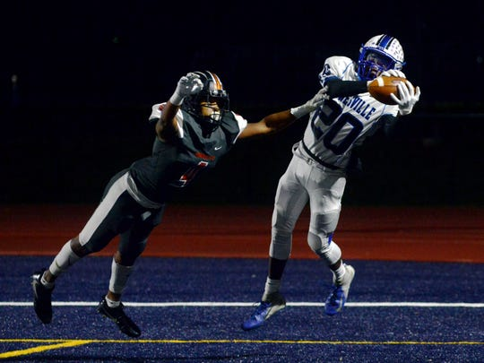 Jamal Wiggins catches an 8-yard touchdown pass during Zanesville's 52-28 win against host Marietta in an East Central Ohio League game at Don Drumm Field. The Blue Devils clinched a playoff berth with the win.