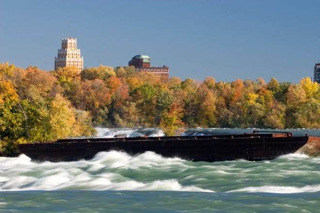 File photo shows the iron scow sitting in the rapids of the Niagara River just above the Horseshoe Falls prior to becoming dislodged this week.