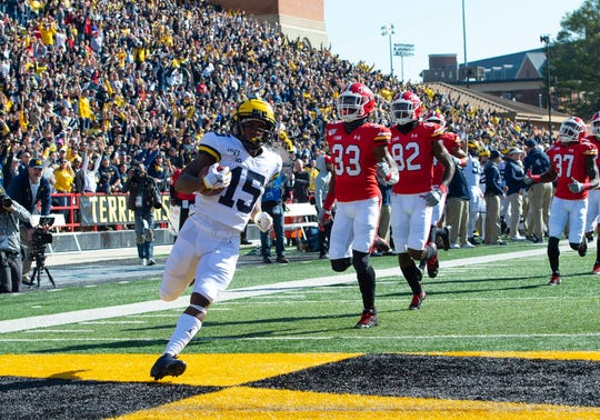 Michigan wide receiver Giles Jackson strolls into the end zone after returning the opening kickoff off for a touchdown against Maryland.