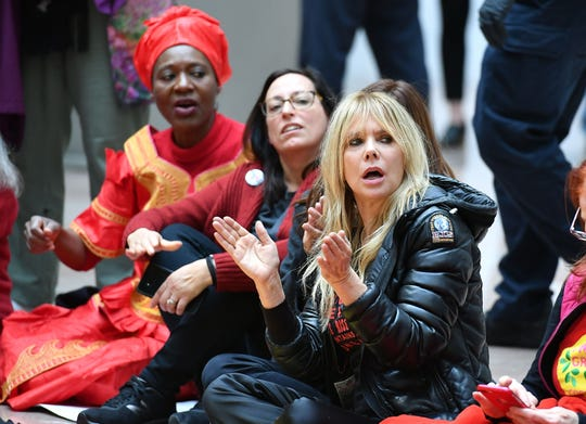 Actress and activist Rosanna Arquette sits with other climate activists inside the Heart Senate office building during a climate change protest on Nov. 1 in Washington, DC.
