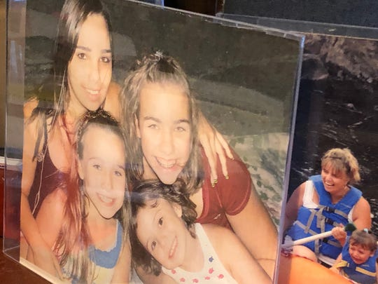 Stephanie Parze and a photo with her sisters sits in her father's office in Freehold.
