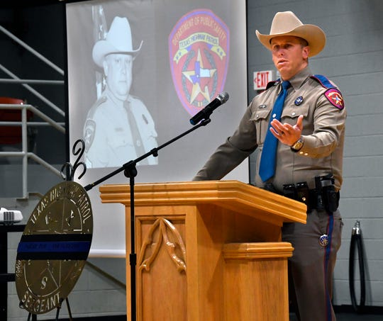 Karlton Keesee, a Texas Department of Public Safety state trooper, speaks during a dedication ceremony naming a portion of U.S. 84 after his father pictured behind him Tuesday.