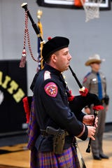 Joel Hanks, a Texas Department of Public Safety trooper assigned to Paris, plays bagpipes as part of the DPS honor guard Tuesday.