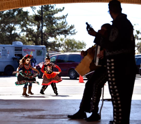 Deziree Garcia (left) and Zolay Gonzalez, both 6, dance to the music of Mariachi real de Abilene at Elliott-Hamil Funeral Homes and Garden of Memories Cemetery on Saturday.