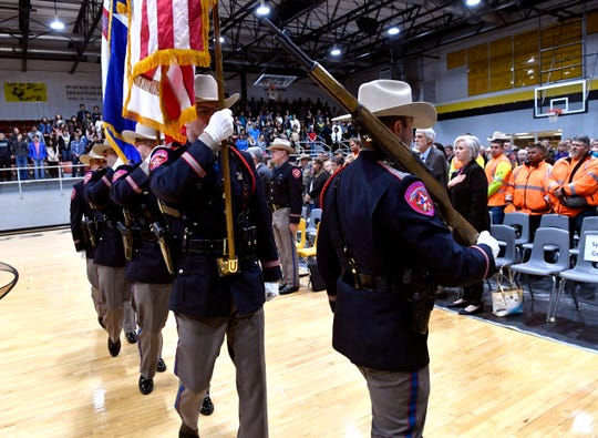 An honor guard of Texas Department of Public Safety state troopers marches in formation Tuesday.