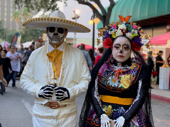 Orlando and Victoria Lemos donned a white Mariachi outfit and a colorful Chiapas dress (similar to a Catrin and Catrina) at the 12th annual Dia de los Muertos Street Festival on Saturday, Nov. 2, 2019.