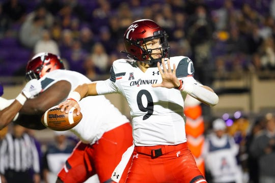 Cincinnati Bearcats quarterback Desmond Ridder (9) throws the ball during the first half against the East Carolina Pirates at Dowdy-Ficklen Stadium on Nov. 2, 2019.