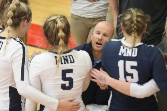 Mount Notre Dame head coach  Chris Lovett talks with his team during their regional final match against Ursuline, Saturday, Nov. 2, 2019.