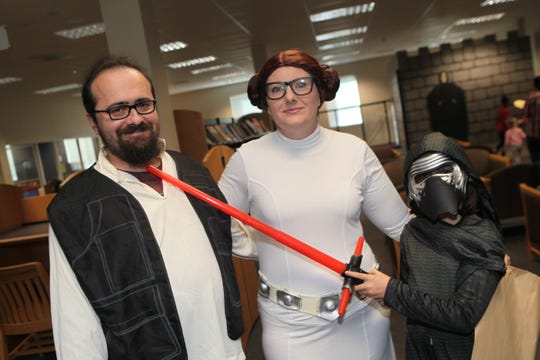 Jason, Erin and Lenore Beauchamp at the Clarksville-Montgomery County Public Library 8th annual Sci-Fi and Fantasy Expo on Saturday, Nov. 2, 2019. Lenore claims Jason is in trouble for not converting to the dark side